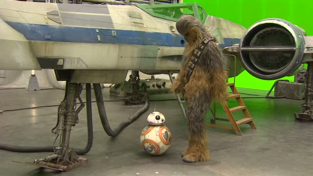 Chewbacca poses with BB8 and a model fighter plane from Star Wars at the set in Pinewood Studios Actor John Boyega and Mark Hamill waited along with...