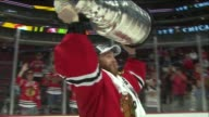 WGN Chicago Blackhawks Players Holding Stanley Cup Over Their Head On The Ice on the night they won the Stanley Cup on June 15 2015 in Chicago...