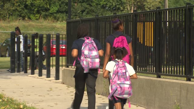 Chicago Public Schools open for the school year Elementary School Students Walking To School at Earle Stem Elementary School on August 26 2013 in...