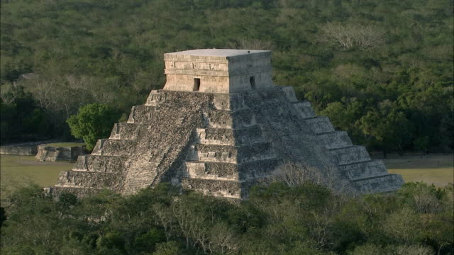 AERIAL Chichen Itza ruins surrounded by rainforest / Cancun, Quintana Roo, Mexico