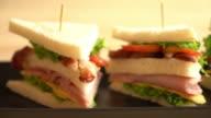 chiciken and ham sandwich on table