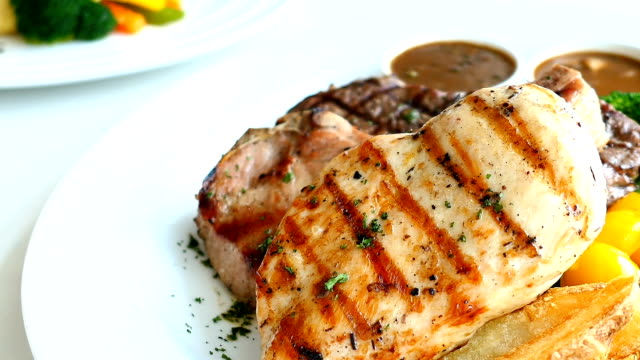 Chicken breast and Pork chop with beef meat steak and vegetable