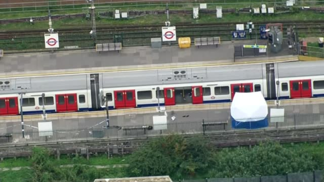 MI5 chief Andrew Parker says scale of terror threat highest he has seen LIB / T15091701 Tube train on platform with forensic tent alongside Parsons...