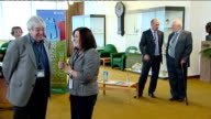 Launch of new adoption service in Leicestershire ENGLAND Leicestershire Leicester INT Various shots of people stadnign chatting informally at...