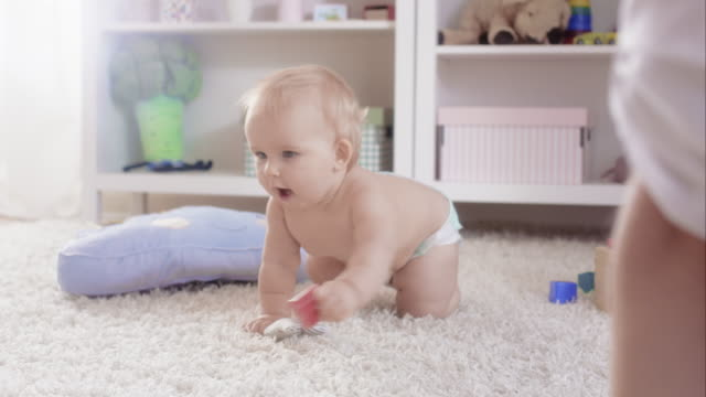 Child crawling on the carpet