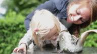 Child drinking water in park