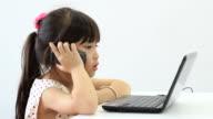 Child girl talking mobile phone.