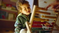 A child playing with his toys of maths