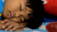 Child sleeping relax daytime.