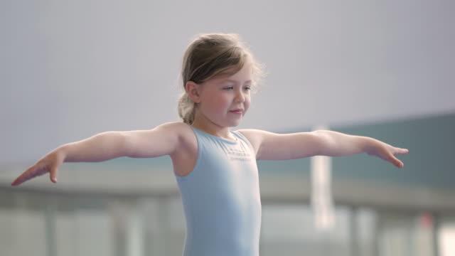 TU Child standing on one leg on balance beam / Vancouver, British Columbia, Canada
