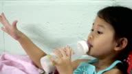 Child suck up milk bottle