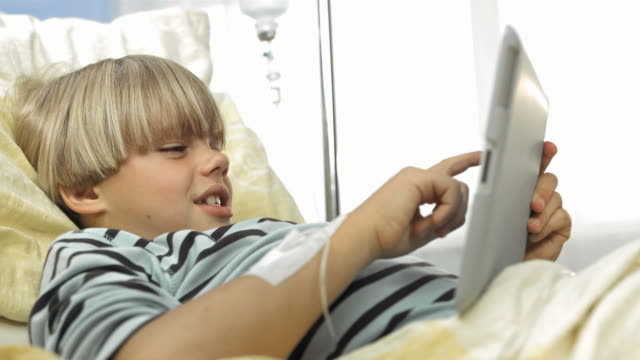 HD: Child Using Tablet In The Hospital