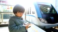 Child Waiting for Train on Platform