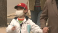 Child wears face mask to protect himself from yellow sand pollution