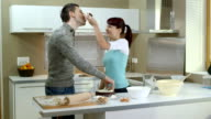 HD DOLLY: Childish Couple Eating A Cake With Hands