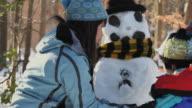 MS PAN Children (2-7) and mother making snowman / Richmond, Virginia, USA