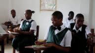 Children began returning to school in Liberia on Monday after lessons were delayed for months by the deadly Ebola outbreak as the country began to...