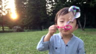 Children blowing bubbles in slow motion