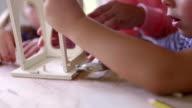Children Building a Birdhouse