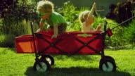 MS Children (2-3) climbing into Red Wagon / Burbank, California, USA