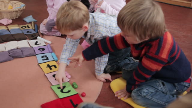 MS Children counting little bags and matching beads / Potsdam, Brandenburg, Germany