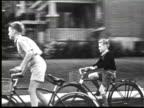 B/W POV  Children cycling on city street, Ottawa, Canada / AUDIO