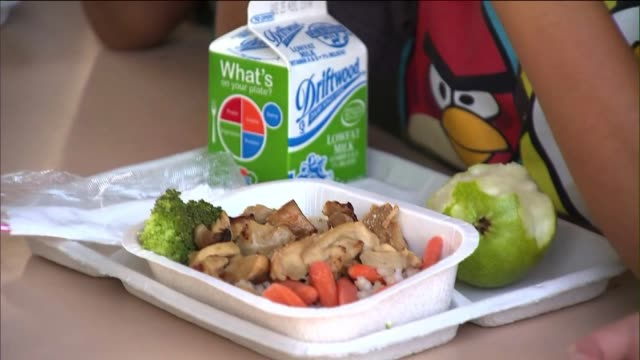 Children Eating Cafeteria Food at School on August 13 2013 in Los Angeles California