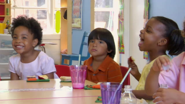 MS PAN Children eating lunch in preschool classroom / San Antonio, Texas, USA
