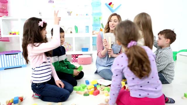 HD: Children Guessing Vegetables in a kindergarden.