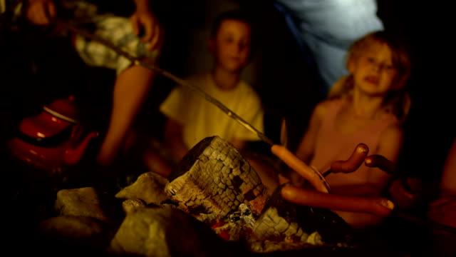 HD: Children Having Fun Around The Campfire