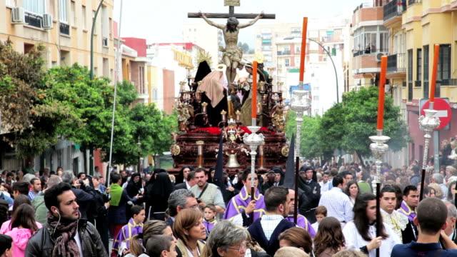 Children in a Religious procession with the Nazarenos, Semana Santa, Malaga, Andalucia, Spain, Europe