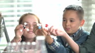 Children in a science lab playing with molecules