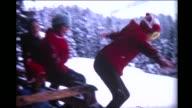 1966 children jumping off Swiss Chalet into snow bank
