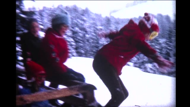 1966 children jumping off Swiss Chalet into snow bank