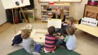 Children learning Spanish in Montessori school environment
