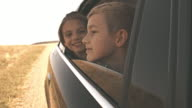 Children looking out car window