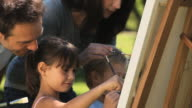 MS TU Children painting on canvas with parents in Park / Cape Town, Western Cape, South Africa