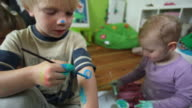MS PAN Children (12-23 months, 2-5 years) painting on themselves / Potsdam, Brandenburg, Germany