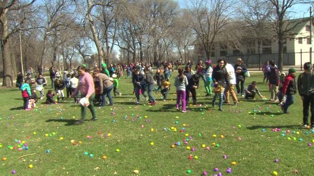 Children participate in Easter Egg Hunt in McKinley Park in Chicago on April 4 2015