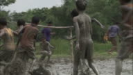 Children play football in mud Available in HD.
