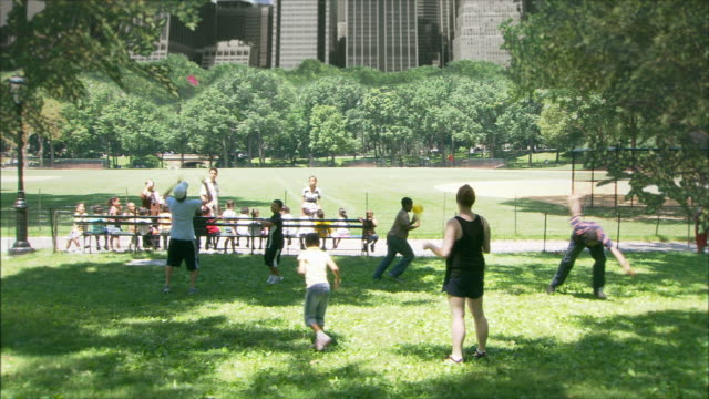 Children play in a park until an alien ship casts its dark shadow over the city.
