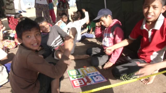 Children play in daycare at a field hospital in Chautara / A major earthquake hit Kathmandu midday on Saturday April 25th and was followed by...