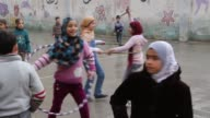 Children play on the school grounds of a newly opened school in Aleppo Syria
