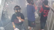 Children play wear gas masks in a gas chamber during Children's Day in the main exhibition ground at the 2nd Cavalry Division headquarters at Sanam...