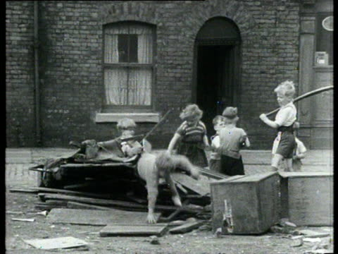 Children play with discarded wood and broken furniture