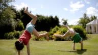 Children Playing Acrobats In the Garden