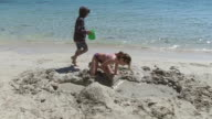 MS Children playing at beach in holiday / Puerto Pollenca, Mallorca, Balearic Islands, Spain