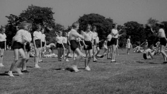1940 MONTAGE Children playing games and exercising in ranks at school / United Kingdom