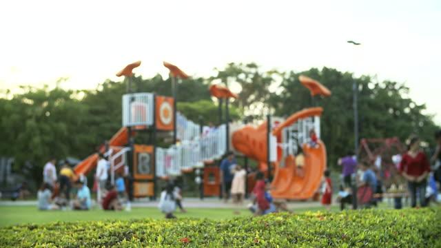 4K: Children playing in outdoor playground
