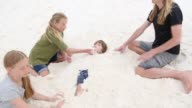 children playing in sand dunes